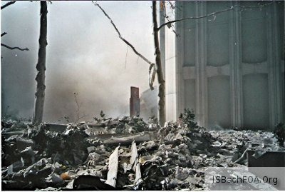 Wreckage from the South Tower, seen from the base of the still-standing North Tower - September 11, 2001